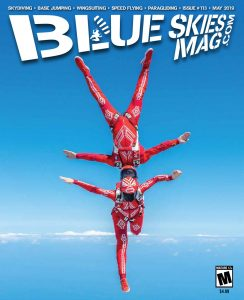 [Two skydivers freefly in red suits.] Blue Skies Magazine i113: May 2019 | On the cover: French freefly Team AirWax members Greg Crozier and Karine Joly photographed above Skydive Sebastian in Florida. Photo by Norman Kent normankent.com